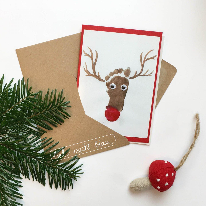 Weihnachtskarte mit kleinem Fußabdruck - Rentier mit Wackelaugen